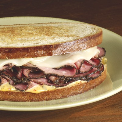 Hot pastrami melt on a plate
