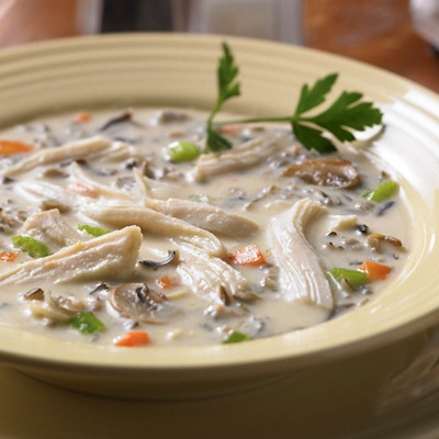 Shredded chicken wild rice soup in a bowl
