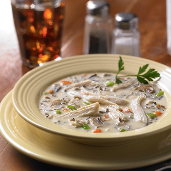 wild rice soup with shredded chicken in a bowl