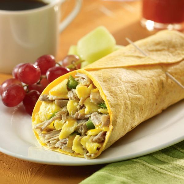 Carnitas breakfast burrito with grapes and melon