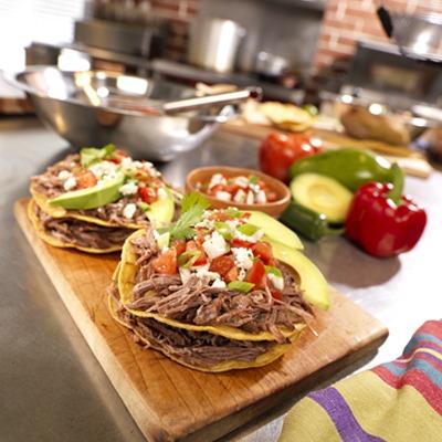 Mexican shredded pot roast tostadas on a tray
