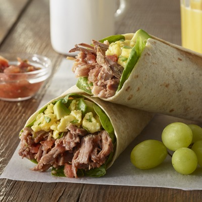 Pot roast breakfast burrito with a side of grapes