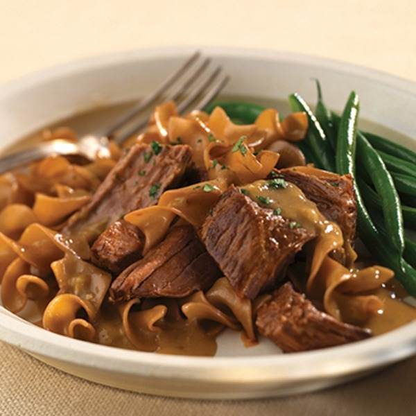 All natural pot roast stroganoff in a bowl with green beans