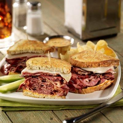 Sourdough sliced pastrami melt sandwich