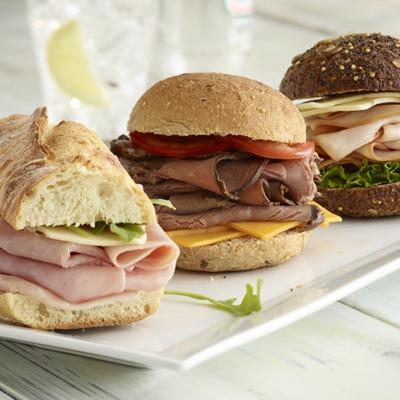 Sliced ham, turkey, and beef sliders on a plate