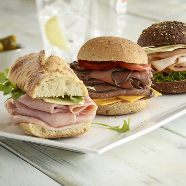 ham, turkey, and beef sliders on a plate
