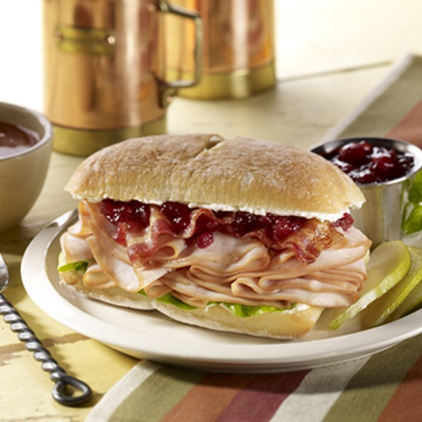 Cranberry turkey club roll on a plate