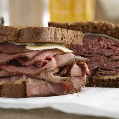 Sliced pastrami sandwich with Swiss cheese