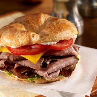 Monterey black and blue croissant sandwich on a paper wrapper