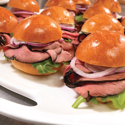 Brioche roast beef sliders on a serving tray