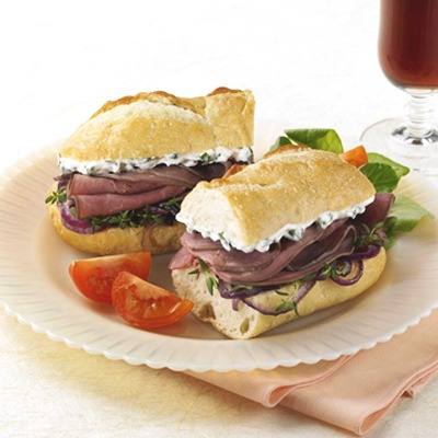 Sour cream and onion beef sandwich on a plate