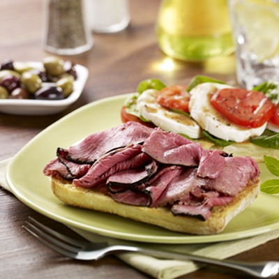 Open-faced beef caprese sandwich on a plate