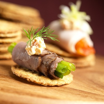 Rolled beef and cream cheese appetizer on a cracker