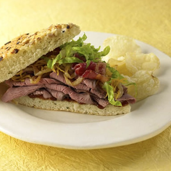 Beef and bacon focaccia sandwich on a plate