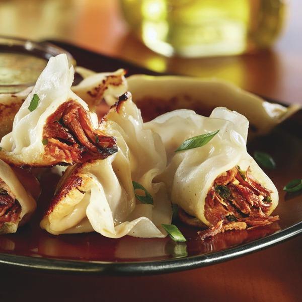 Seared garlicky pot roast dumplings on a plate