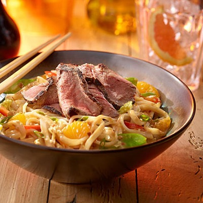 Sirloin Asian noodle bowl with peanut dressing and chopsticks