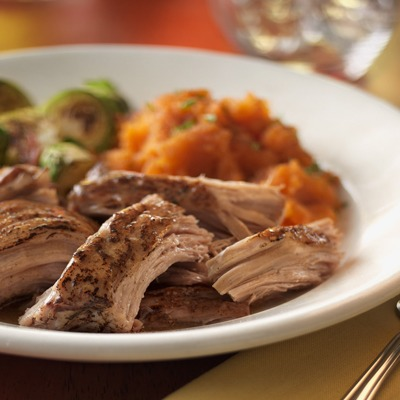 Southern style pork pot roast in a bowl with veggies