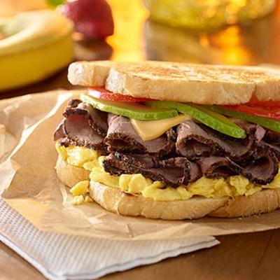 Steak and egg breakfast sandwich in a paper wrapper