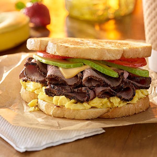 Steak and egg breakfast sandwich on a paper wrapper