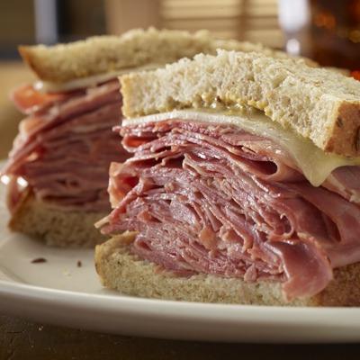 Sliced corned beef sandwich on a plate