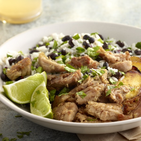 Cuban shredded pork in a bowl with black beans and rice