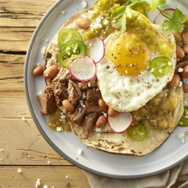 Pot roast huevos rancheros on a plate