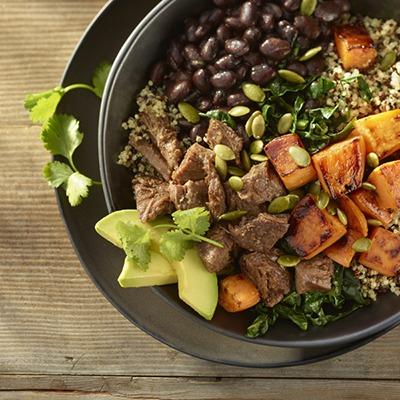 Pot roast beef bowl with black beans, quinoa, sweet potatoes, avocado, cilantro, and pumpkin seeds