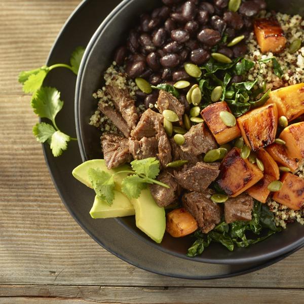 Pot roast beef bowl with beans, quinoa, sweet potatoes, avocado, cilantro, and pumpkin seeds