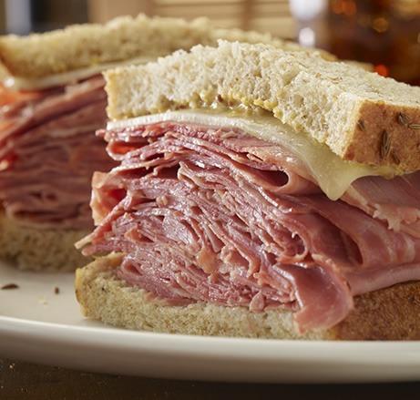 New York deli sliced corned beef sandwich on a plate