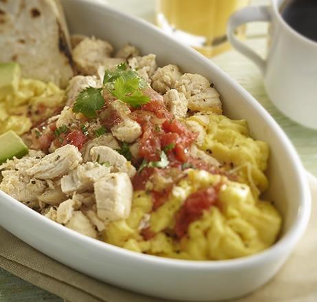 Shredded chicken breakfast bowl with eggs, salsa, avocado, and tortillas