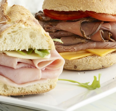 Sliced meat sandwiches on a plate