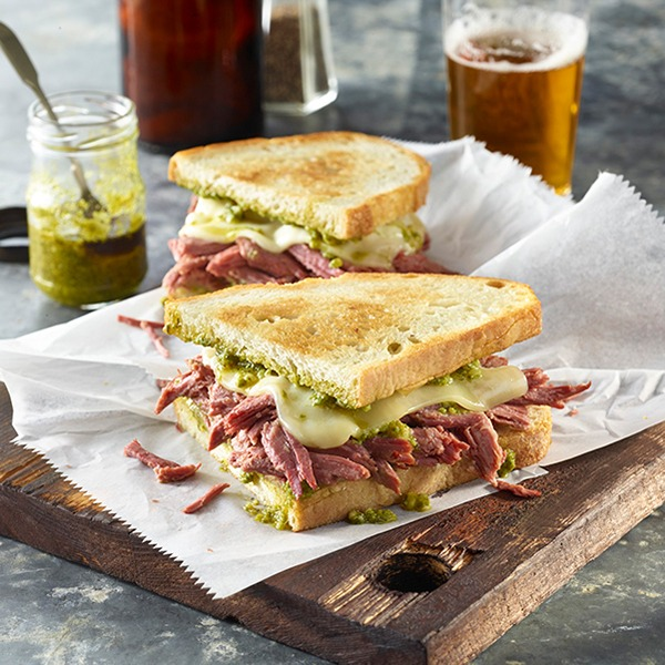 Corned beef pesto grilled cheese on a platter